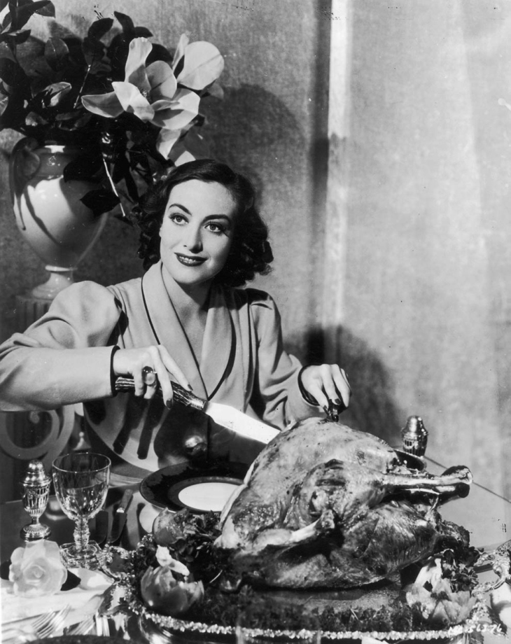 Joan Craford carving Turkey